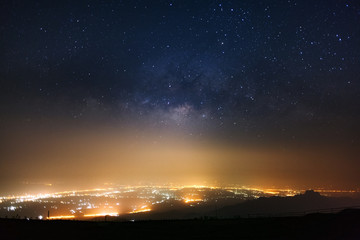 Milky way galaxy over mountains at Phutabberk Phetchabun in Thailand. Long exposure photograph.with grain
