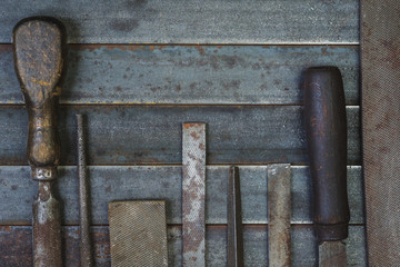 Set of various equipment, rasps for use in the hand with copy space, carpenter tool old rusty metal background.