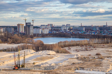 View from the roof to the wasteland - the site of future construction, a reservoir and modern houses