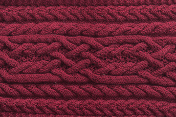 Knitted pattern from natural wool. Texture, close-up red