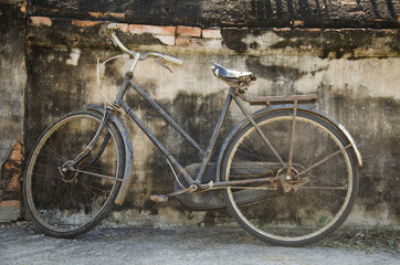 Vintage old classic bicycle against stop at the wall