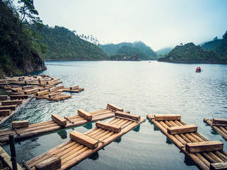 Wooden raft on a tropical lake, Mexico