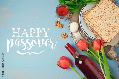 Jewish holiday passover pesah greeting card with seder plate matzoh jewish holiday passover pesah greeting card with seder plate matzoh and flowers over blue background m4hsunfo