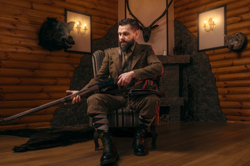 Hunter man in vintage clothing with antique rifle