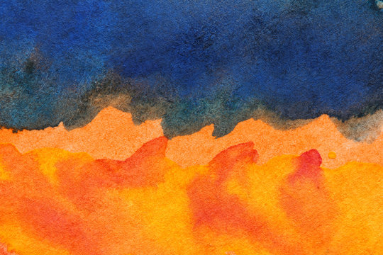 orange and dark blue paint strokes on  watercolor paper texture, abstract background