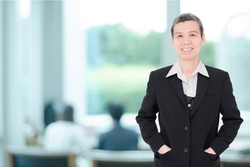 Senior asian businesswoman working at office