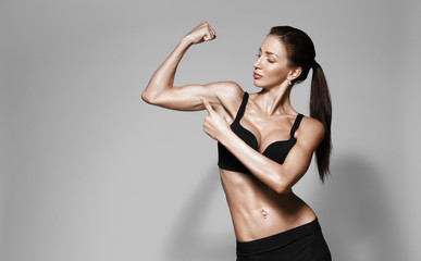 attractive fitness woman, trained female body, lifestyle portrait