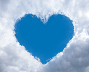 heart frame made of fluffy clouds in blue sky