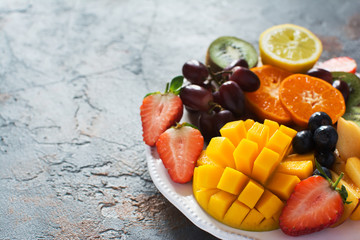 Wall Mural - Raw fruits and berries platter