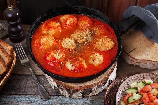 pan vegan meatballs Tomato sauce, vegan meatballs on a plate top view still life