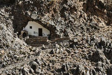 Orthodox chapel in a rocky cave on the Greek island of Crete.