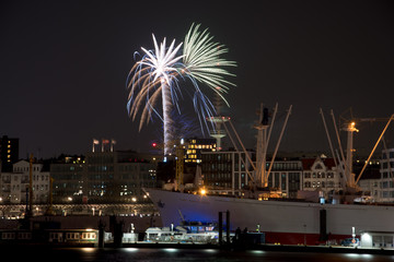 Panorama over the harbour of Hamburg Germany with fireworks