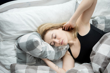 Young woman sleeping in her bed.
