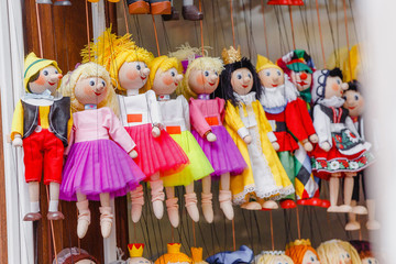 Traditional toy puppets made of wood in souvenir shop