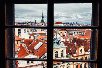 Beautiful View On Prague red roofs from the window of the hotel or restaurant
