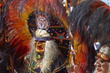 Tobas dancers in colourful costumes performing at the annual Oruro Carnival. The event is designated by UNESCO as being Intangible Cultural Heritage of Humanity.