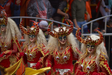 Masked Diablada dancers in ornate costumes parade through the mining city of Oruro on the Altiplano of Bolivia during the annual carnival.
