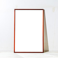 Mockup empty poster frame on a tbale