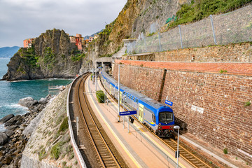 Deurstickers Noord Europa Manarola, Italy - may 12, 2016: train station with unidentified people in Manarola. Manarola is one of the 5 picturesque villages of the Cinqueterre, they are listed under UNESCO world heritage sites