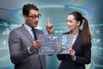 Pair of businessman and businesswoman discussing data