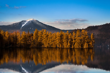 Snowy Whiteface mountain with reflections in Paradox Bay, Lake Placid, Upstate New York