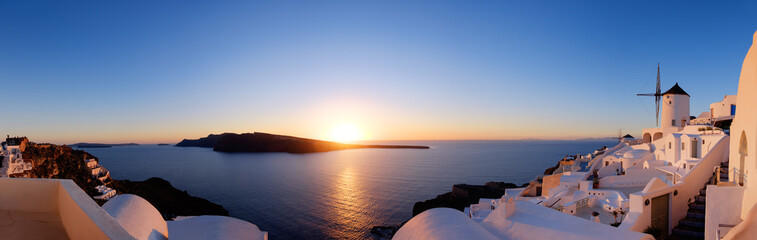 Aluminium Prints Santorini Traditional apartments and windmills in Oia village on a sunset, panoramic image