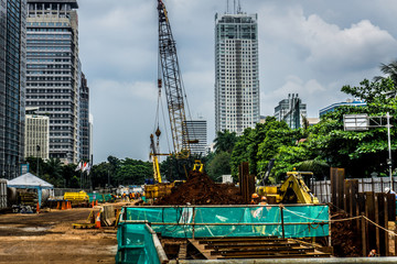 Construction site with materials and equipments near high rise building photo taken in Jakarta Indonesia