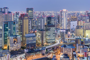 Osaka city view with osaka expressway and high building at twilight