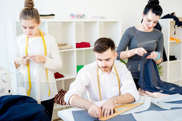 Three tailors work