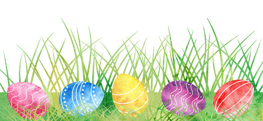 Watercolor Easter eggs at green grass