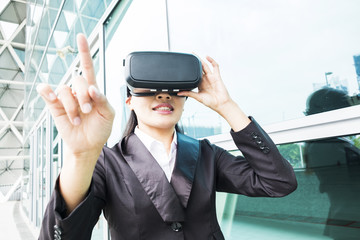 asian business woman point pressing touch screen by virtual reality