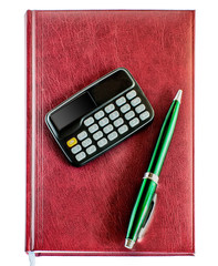Notebook, pen and calculator from above