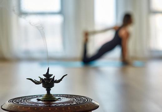Yoga practitionar and smoking incense