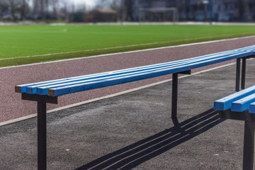 Wooden bench seats for fans on soccer football field