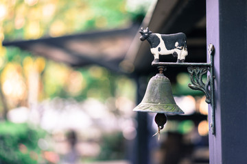 Bell cow milk Hanging on a pole in the garden