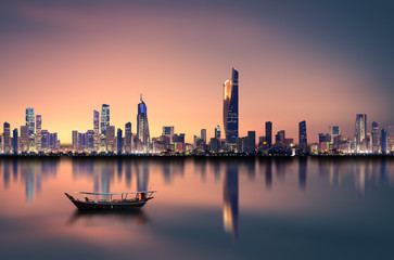 kuwait city skyline during sunset