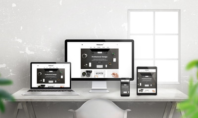 Creative flat responsive web site promotion on different devices. Profesional web design studio. Office desk with devices. Wall and window in background.