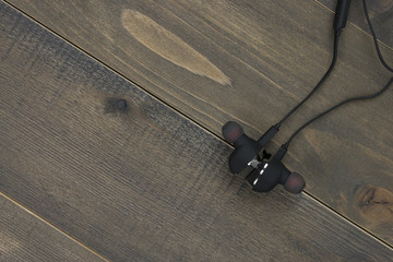 earphones on wood desk with copy space.