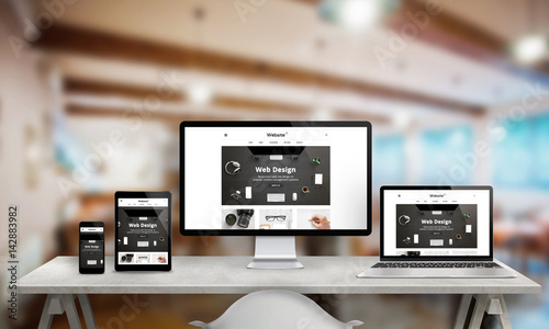 Wall mural Web design studio promotion on multiple devices. Responsive web site on computer display, laptop, tablet and smart phone. Modern clean design with clean creative images.