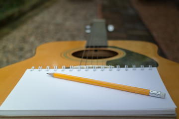 Yellow Acoustic Guitar On Wooden Table