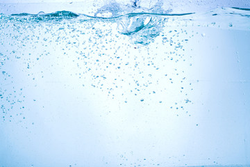 Flowing water, drops, sprays, splashes on a neutral background