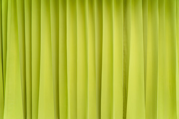 Bright green cloth on the wall.