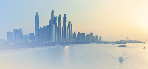 Dubai Marina skyline illuminated by evening sunlight
