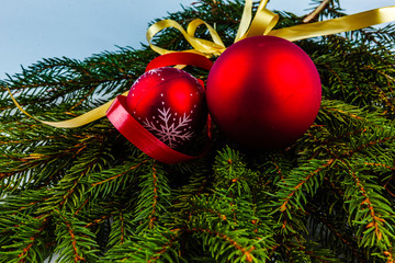 Christmas decorations with red balls and gold ribbons.