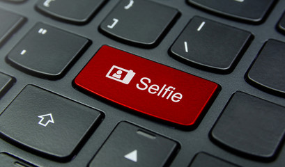 Close-up the Selfie button on the keyboard and have Red color button isolate black keyboard