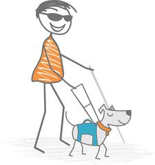 Un aveugle avec une canne blanche est assisté par un chien