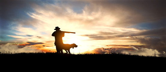 Acrylic Prints Hunting hunter with dog at sunset