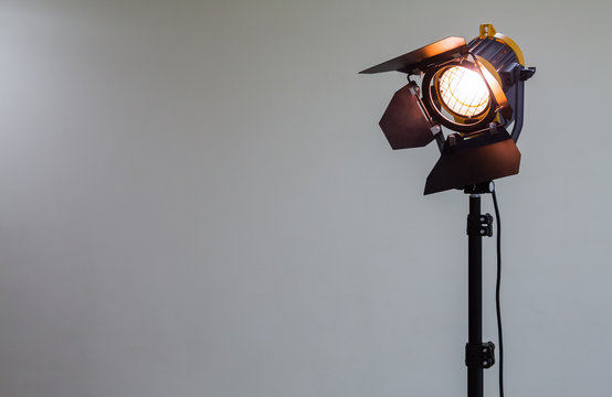 Spotlight with halogen bulb and Fresnel lens. Lighting equipment for Studio photography or videography.