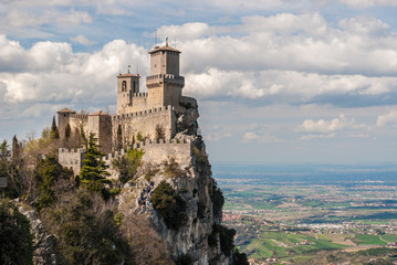 The fortress of Guaita in San Marino; plains of Romagna in the background Wall mural