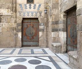 Two doors at the main courtyard of Al-Sultan Al-Zahir Barquq mosque. Al-Moez Street, Old Cairo, Egypt